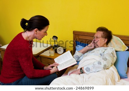 Sick senior is visited by daughter - stock photo