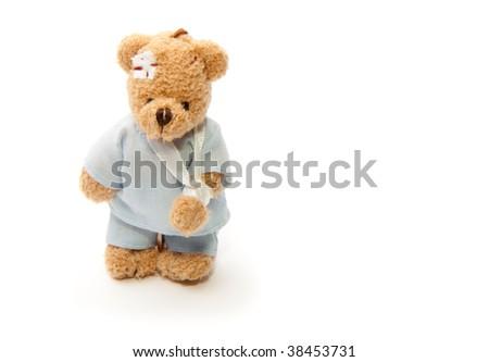 Sick teddy bear isolated on white background - stock photo