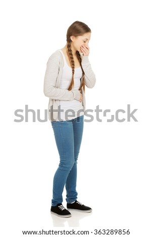 Sick teen woman about to vomit. - stock photo