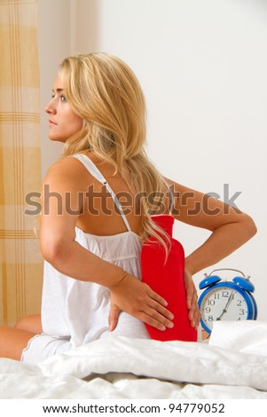 sick with pain in the back. intervertebral disc and spine. - stock photo