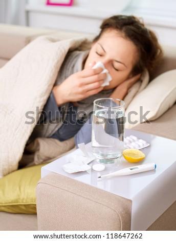 Sick Woman.Flu.Woman Caught Cold. Sneezing into Tissue. Headache. Virus .Medicines - stock photo