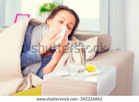 Sick Woman .Flu. Woman Caught Cold. Sneezing into Tissue. Headache. Virus .Medicines - stock photo