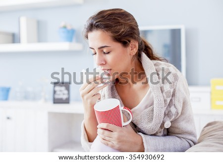 Sick Woman, Flu Woman. Caught Cold. Woman with hard headache, sneezes Shallow depth of field. - stock photo