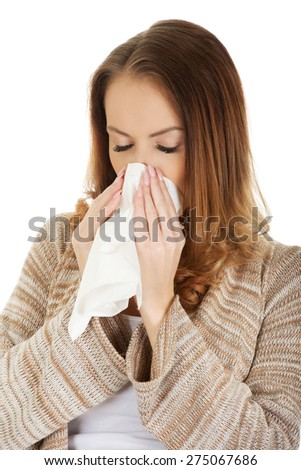 Sick woman sneezing into tissue. - stock photo
