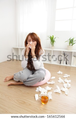 Sick Woman sneezing into Tissue. Flu. Woman Caught Cold. Headache. Virus .Medicines - stock photo