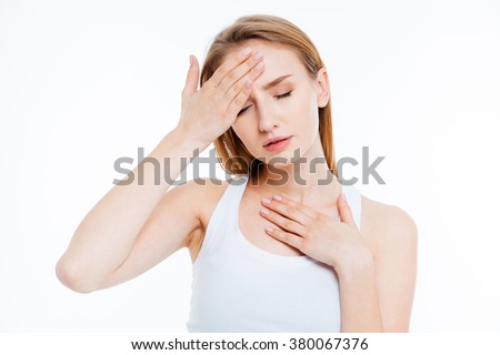 Sick woman touching her head isolated on a white background - stock photo