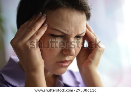 Sick woman with headache at home with pills - stock photo