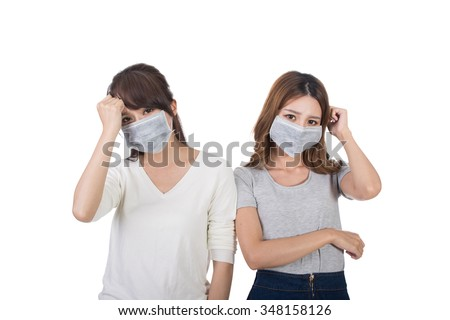 Sick woman with her friends with mask. - stock photo
