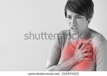 sick woman with sudden heart attack symptom - stock photo