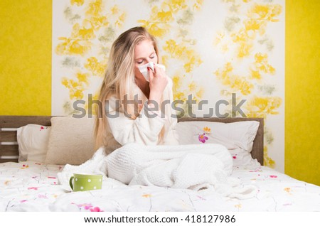 Sick womanin bed. Ill girl caught cold flu. Pills and tea  - stock photo
