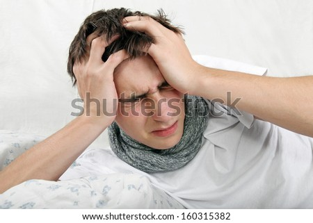 Sick Young Man feels Headache and lying on the Bed - stock photo