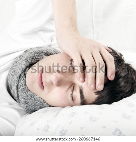 Sick Young Man sleep on the Bed at the Home - stock photo