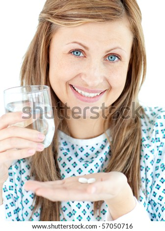 Sick young woman holding a glass of water and pills against white background - stock photo