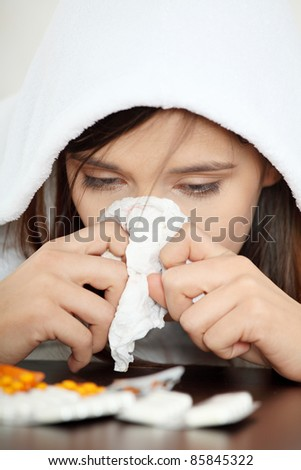 Sick young woman in bathrobe - stock photo