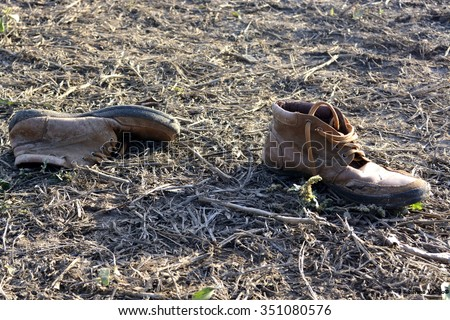 Sid, Serbia - October 2nd, 2015: Old shoes left behind by Syrian refugee on his way to European Union States. Photo taken on the border between Serbia and Croatia, near the town of Sid and Tovarnik.