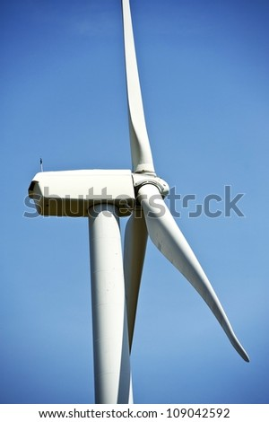 Side Closeup of Wind Turbine. Alternative Energy Theme. Vertical Photography