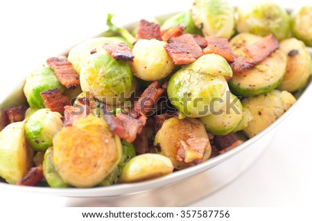side dish of brussels sprouts with diced bacon for a holiday feast - stock photo