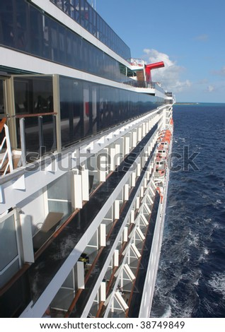 Side of cruise ship on the open seas showing balconies