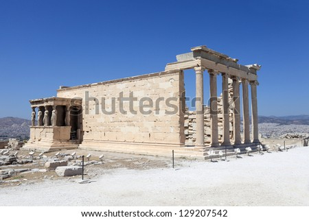 Side of Erechtheum ancient temple at acropolis of Athens in summer, Greece