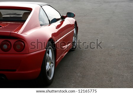 side of red ferrari F355 as the sun goes in - stock photo
