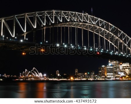 side of Sydney harbour bridge with Sydney city in the background  - stock photo