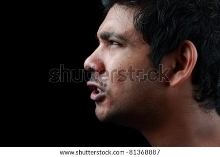 Side portrait of a angry man