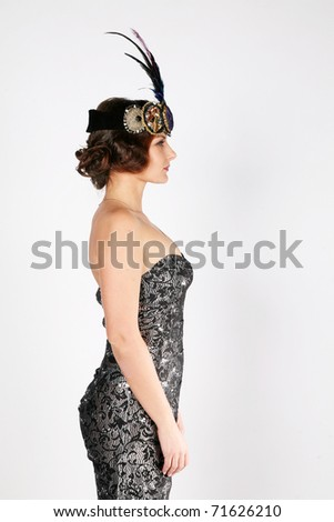 Side portrait of a sexy female dressed as in 30's - stock photo