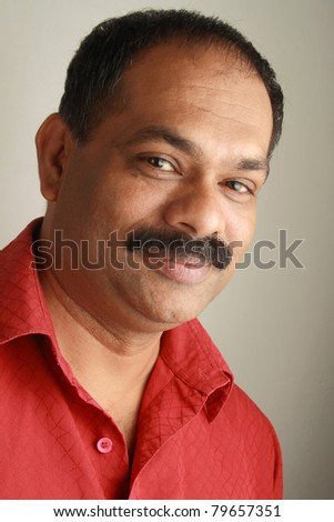 Side portrait of an Indian male - stock photo