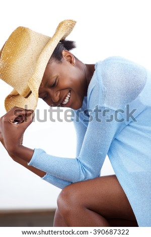 Side portrait of cheerful young african woman with a cowboy hat - stock photo