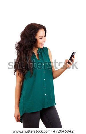Side portrait of smiling woman holding cell phone