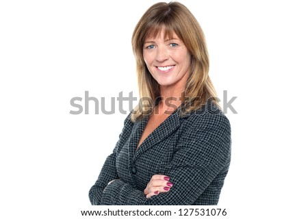 Side profile of a gorgeous middle aged corporate lady posing with folded arms. - stock photo