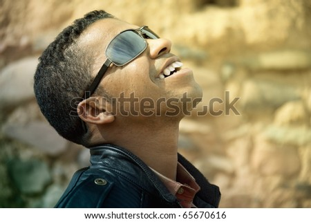 Side profile of a happy smiling african man looking up. - stock photo