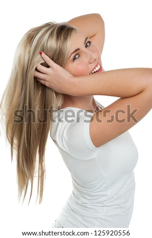 Side profile of a teen girl playing with her hair. Isolated over white.