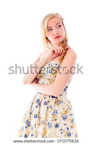 Side profile of a young woman standing - stock photo