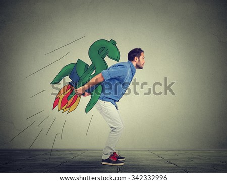 Side profile of ambitious young man with high risky financial goals on gray wall background  - stock photo