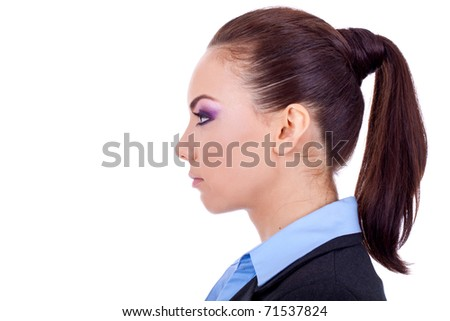 Side profile of an attractive young brunette woman, isolated on a white background. - stock photo
