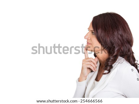 Side profile portrait serious beautiful mature woman thinking finger on lips gesture looking up isolated white background copy space. Human face expression emotion feeling body language perception - stock photo
