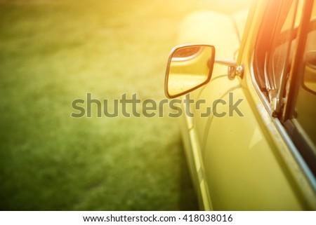 Side rear-view mirror on retro car - stock photo