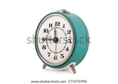 Side shot of old soviet mechanical alarm clock isolated on white background