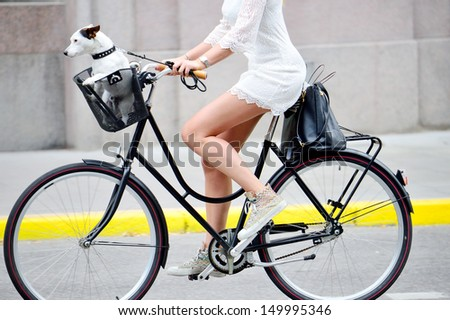 Side shot of woman on bike - stock photo