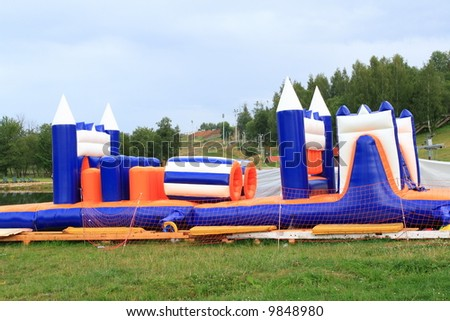 "Side-show ""pneumatic castle"" in the park - stock photo"