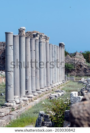 SIDE, TURKEY - JULY 01: Ruins of ancient city in Side on July 01, 2014 in Side, Turkey. Side Antique city is a great treasury of antiques.