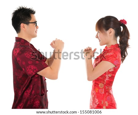Side view Asian man and woman with Chinese traditional dress cheongsam. Chinese new year concept, isolated on white background. - stock photo