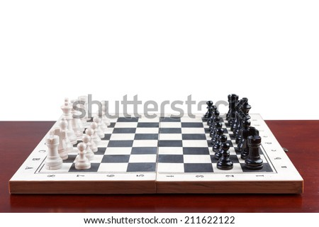 side view chess board set up to begin a game on white background with clipping path - stock photo