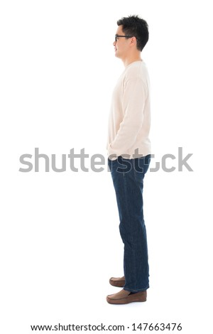 Side view full body casual Asian man standing isolated on white background - stock photo
