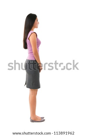 Side view full body of Asian female in office attire standing over white background - stock photo