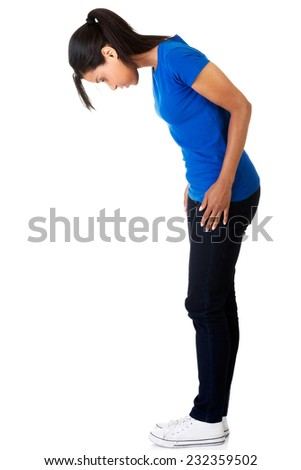 Side view full length woman looking down. - stock photo