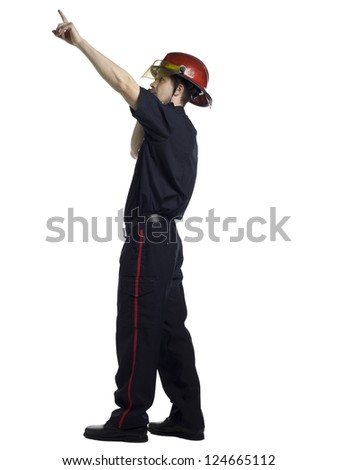 Side view image of a firefighter pointing up isolated on a white surface - stock photo