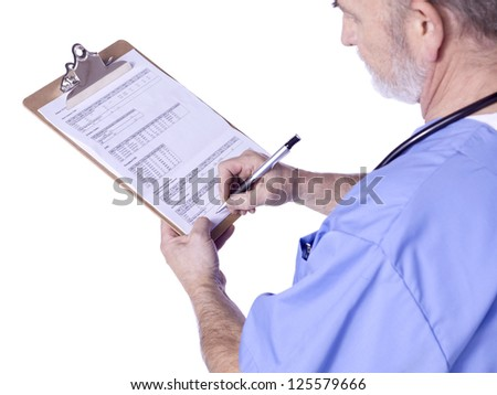 Side view image of a male doctor standing writing on the medical clipboard - stock photo
