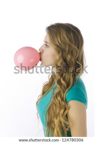 Side view image of a woman blowing chewing gum in a side view image - stock photo